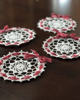 Lovely lace crochet coasters with pink ribbon